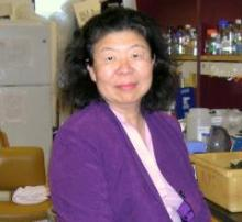 """""""Alice Cheung in the lab, smiling"""""""